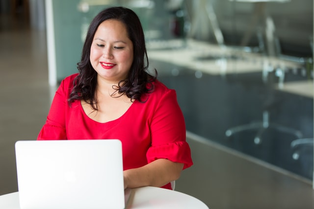 woman in red with laptop