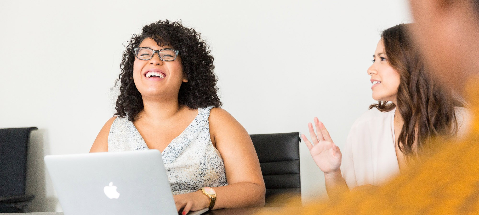 woman laughing mazevo meeting room scheduling-1